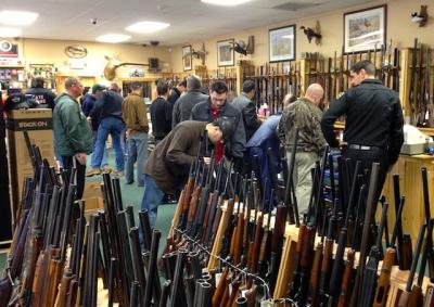 Gun salesman-in-chief: 52,600 a day under Obama, more seen under Hillary